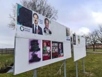 Verkiezingsposters en doeken van de gemeente beklad