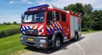 Containers in brand tegen gevel van woning in Follega
